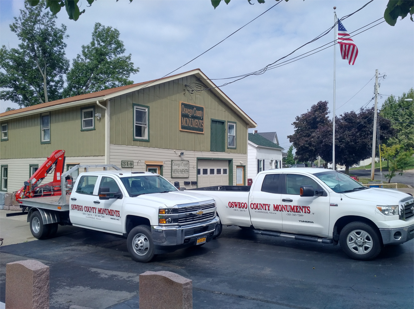 photo of building with 2 setting trucks